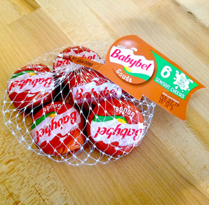A 6-pack of Babybel Gouda cheese.