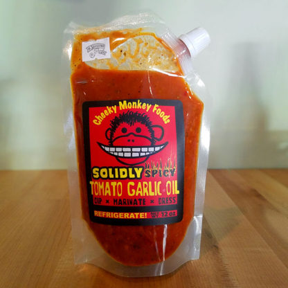 A pouch of Solidly Spicy Cheeky Monkey Garlic Tomato Oil.