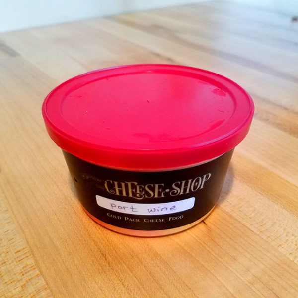 A container of Port Wine Cheese Spread.