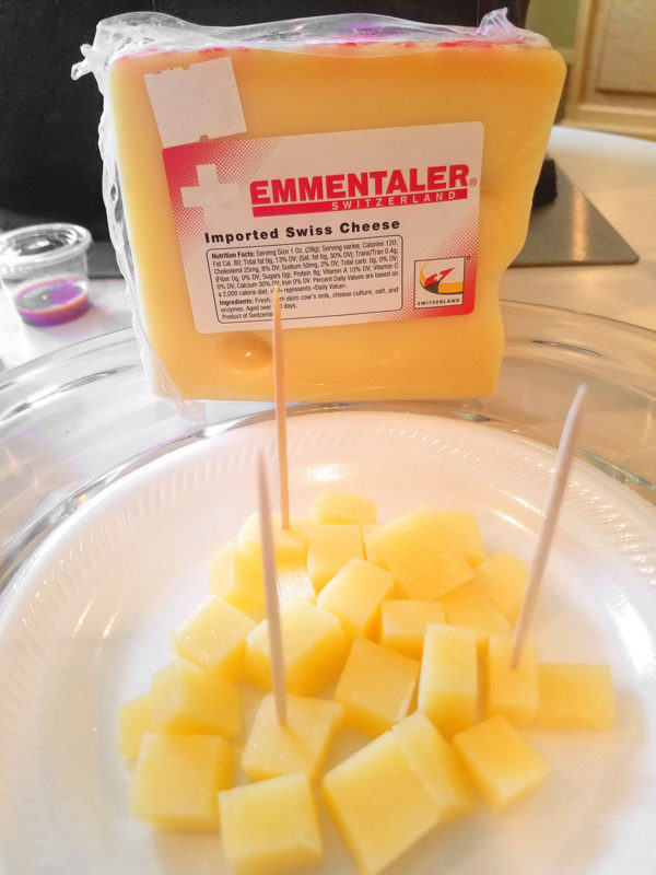 A plate of cubed Emmentaler cheese.