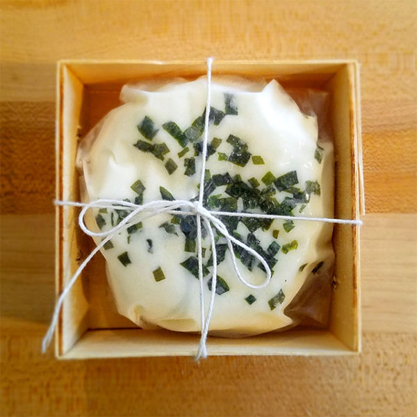 A boxed 5 oz. disc of Hidden Pastures Dairy Chive Chevre.