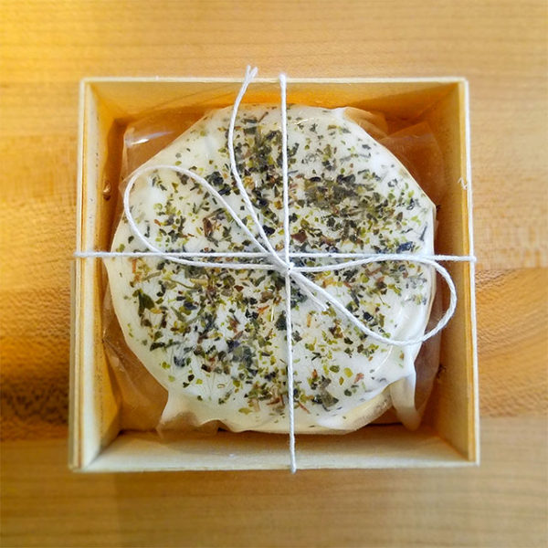A boxed 5 oz. disc of Hidden Pastures Dairy Italian Chevre.