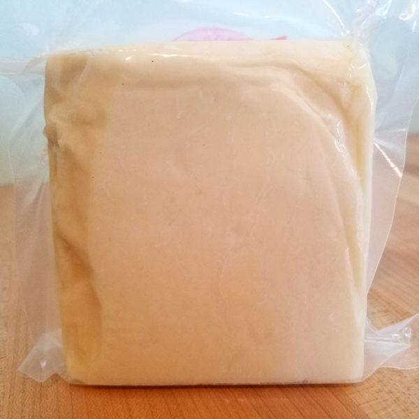 A brick of 5-year aged cheddar cheese.