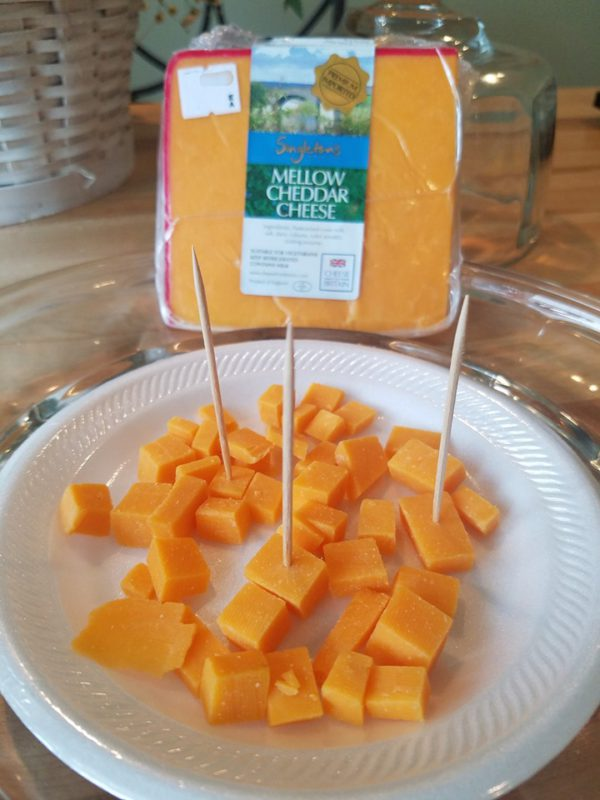 A wedge and plate of Singleton's Mellow Cheddar.
