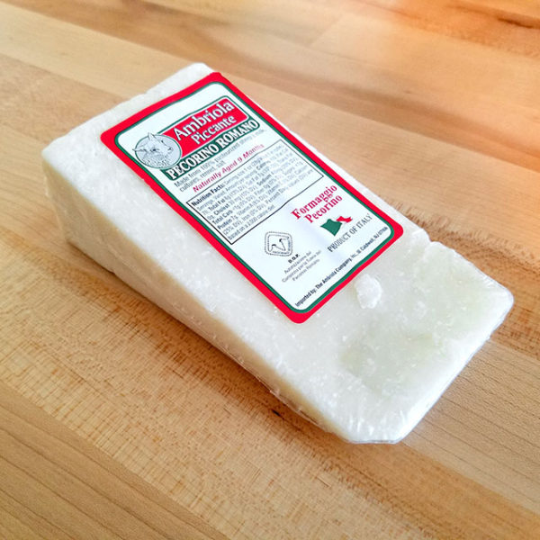 A wedge of Pecorino Romano cheese.
