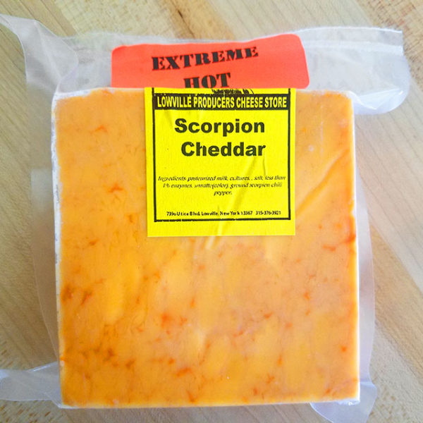 A brick of Scorpion Cheddar cheese.