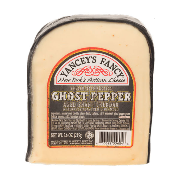 A wedge of Ghost Pepper Cheddar Cheese.