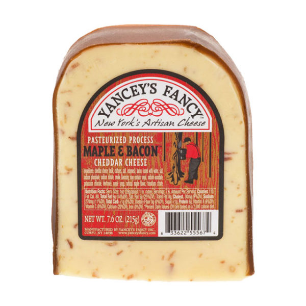 A wedge of Maple Bacon Cheddar cheese.