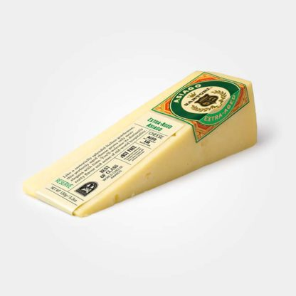 Wedge of Extra-Aged Asiago cheese.