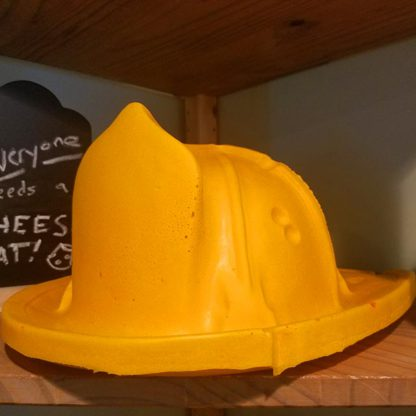 A yellow Firefighter Hat made of foam that looks like real cheese.