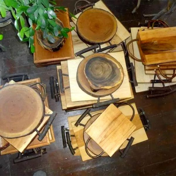 An assortment of rustic, wooden cutting boards.