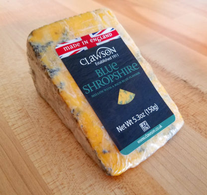 A sealed wedge of Shropshire Blue cheese.