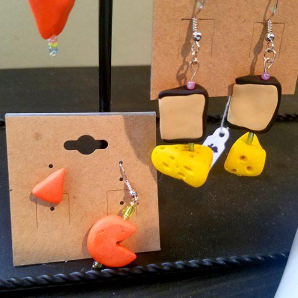 Various handmade cheese earrings by Brie-joux Handmade Jewelry.