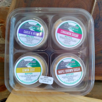 A 4-pack sampler of Black River Valley Natural flavored butters.