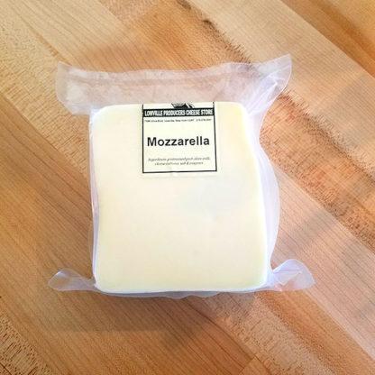 A brick of Mozzarella cheese.