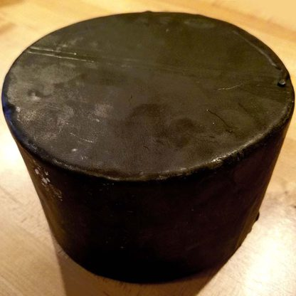 3 lb. Wax Dipped Sharp Cheddar Cheese Wheel, without label.
