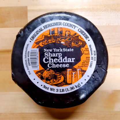 3 lb. Wax Dipped Sharp Cheddar Cheese Wheel, still wrapped.