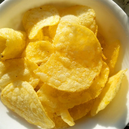 A closeup of White Truffle Potato Chips.