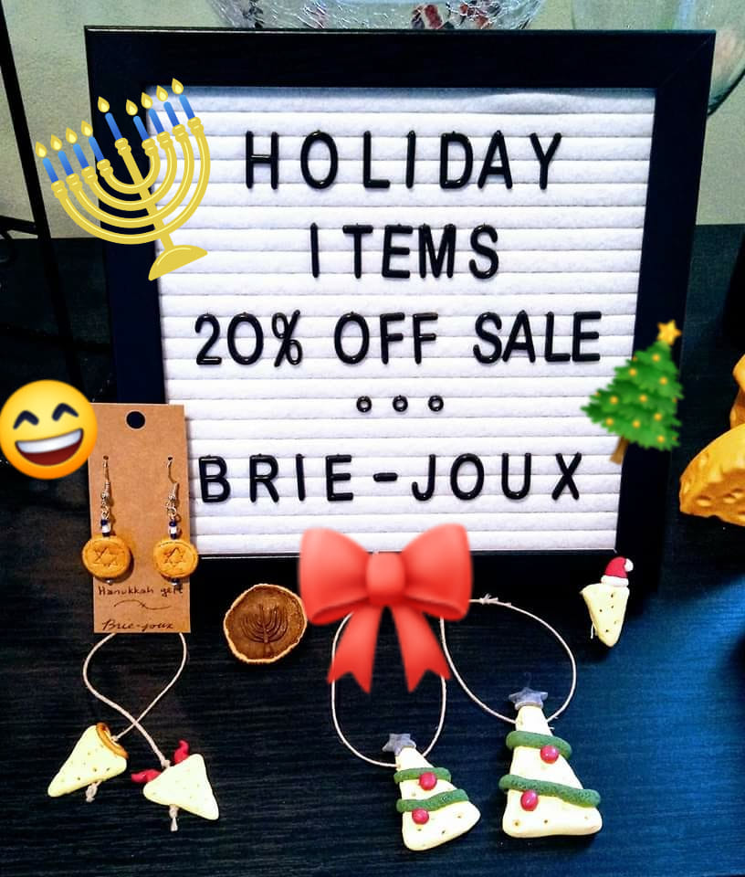 """Assoted Brie-joux holiday items and a """"sale"""" sign."""