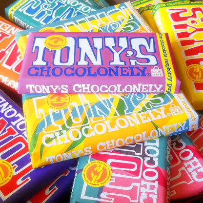 A stack of Tony's Chocolonely chocolate bars.