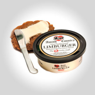A tub of Amish Country Limburger Spread and a piece of bread being slathered in cheese.