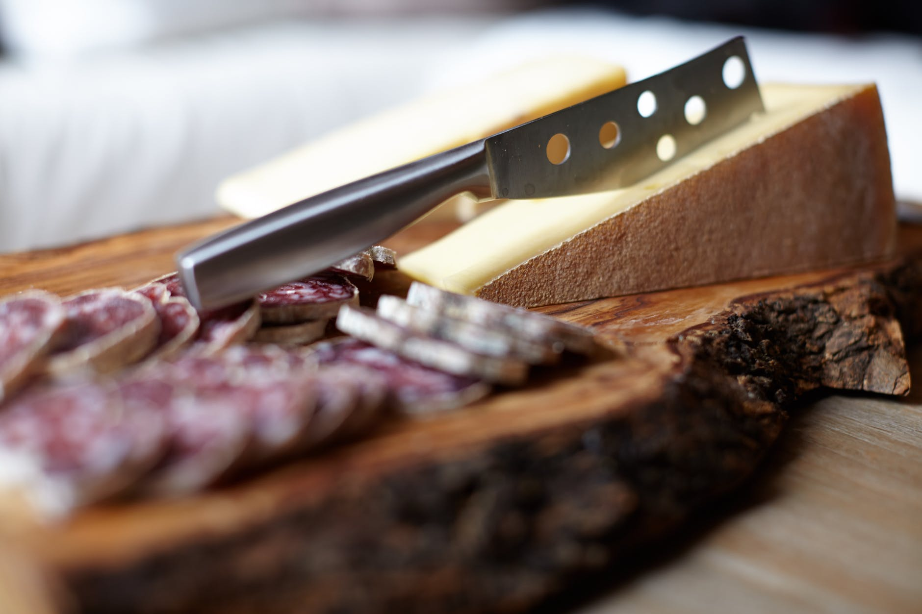 Steel knife on chopping board.