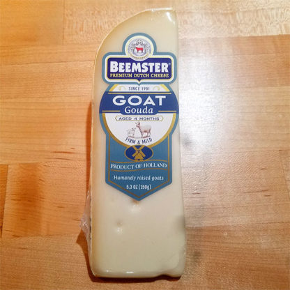 A wedge of Beemster Goat Gouda.
