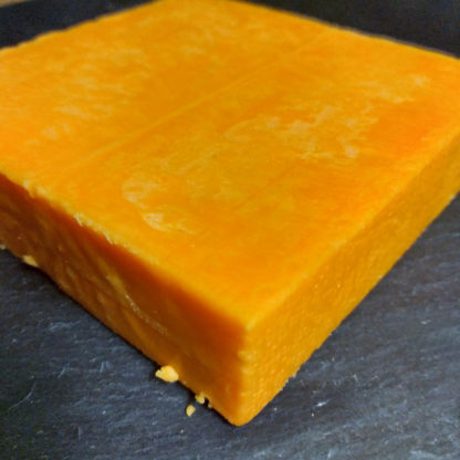 A block of Red Fox Aged Red Leicester cheese.