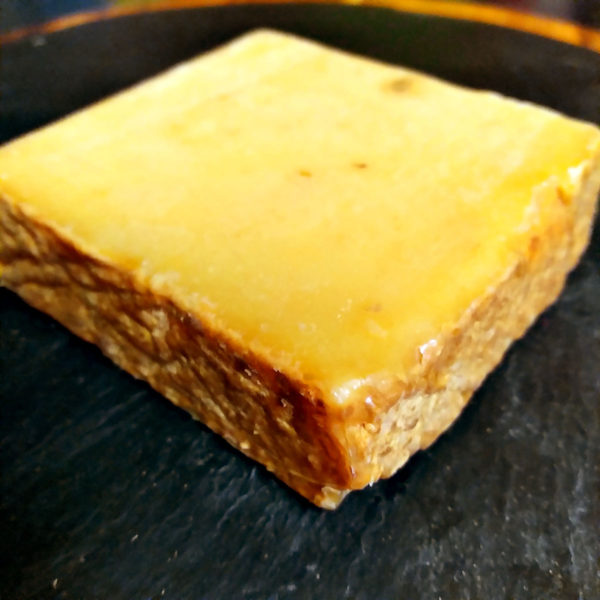 A block of Jasper Hill Cave Aged Cheddar cheese.