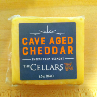 A block of Cave Aged Cheddar cheese.