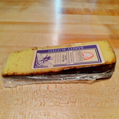 A wedge of Barely Buzzed Beehive Cheese.
