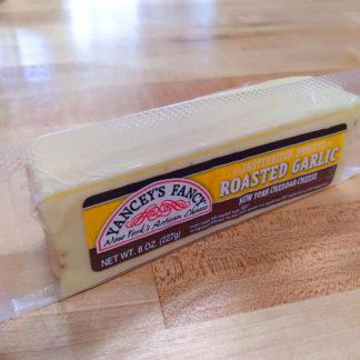 A block of Yancey's Fancy Roasted Garlic Aged Cheddar cheese.