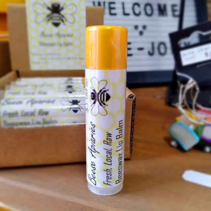 A stick of Beese Apiaries Beeswax Lip Balm.