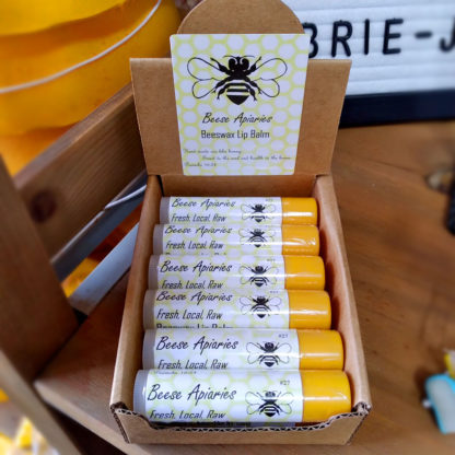 A box of Beese Apiaries Beeswax Lip Balms.