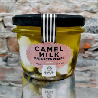 An unopened jar of Camel Milk Marinated Cheese.